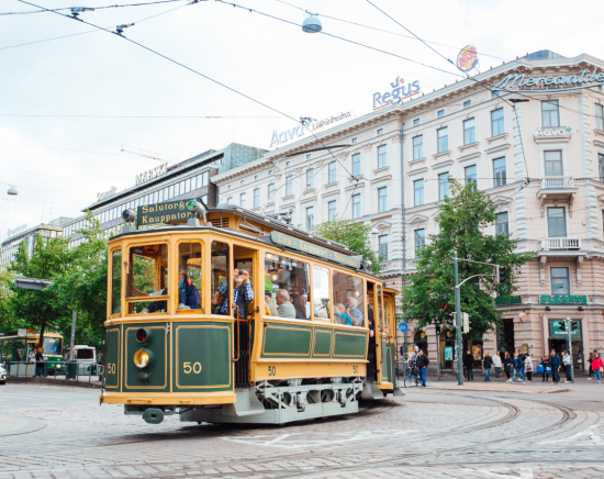 The city tram in Helsinki rolls through town