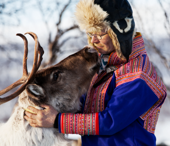 A herder and reindeer are dependent on each others well being in an inhospitable climate.