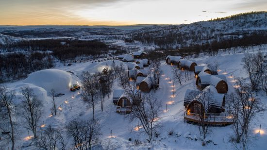 Winter aerial view of Gamme Cabins at the Snowhotel Kirkenes.