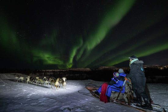 Husky Safari successfully finding the Northern Lights