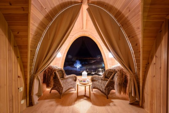 From the inside looking out, from the comfort and warmth of your Gamme Cabins at the Snowhotel