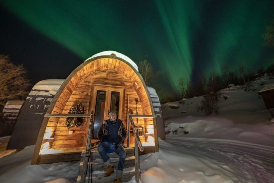 Kirkenes Snowhotel - Northern Lights over the Gamme cabins