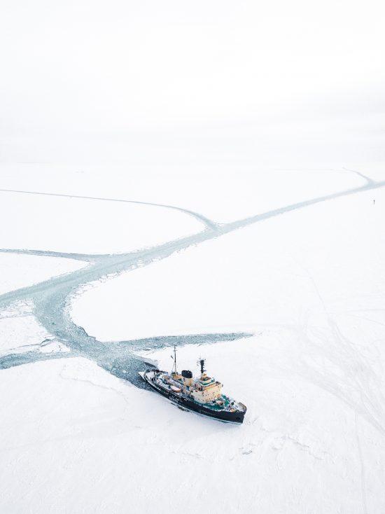 Icebreaker Sampo cutting a path through the frozen sea